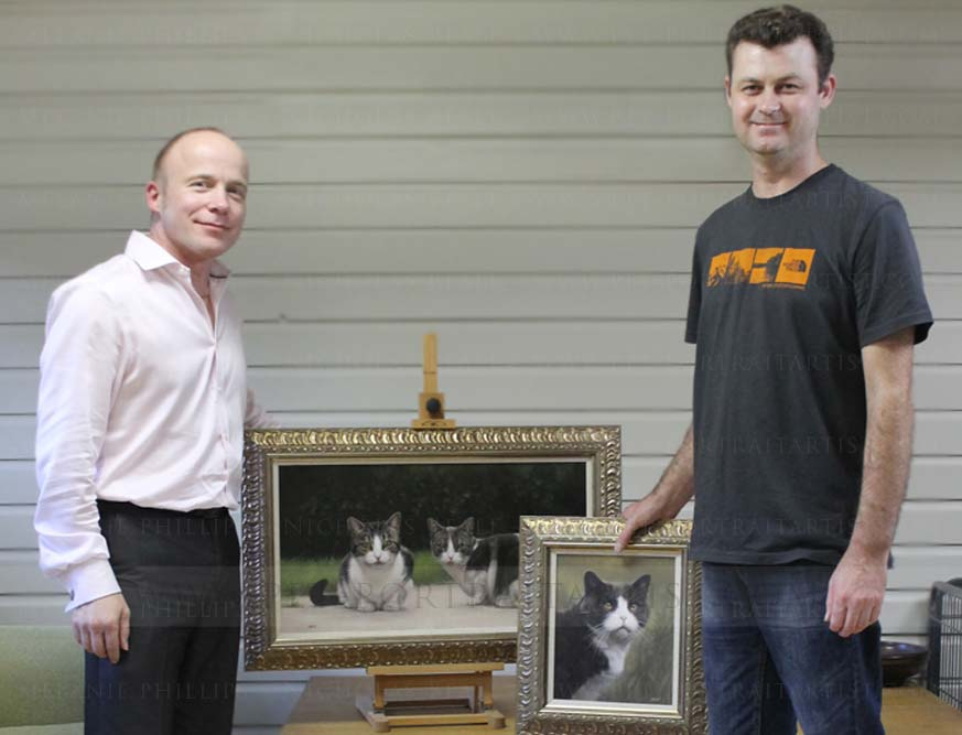 Alan and Nicholas with cat portraits